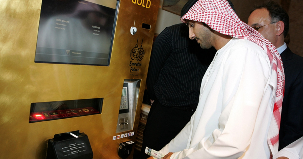 An Emirati man tries the 'Gold to Go' vending machine at the Emirates Palace Hotel in Abu Dhabi in May, 2010. The well-heeled in the Gulf can now grab 'gold to go' from a hotel lobby in the United Arab Emirates, when the need for a quick ingot strikes. The machine, itself covered in 24-carat gold, dispenses one, five and 10 gram bars as well as one ounce bars of gold.</p>