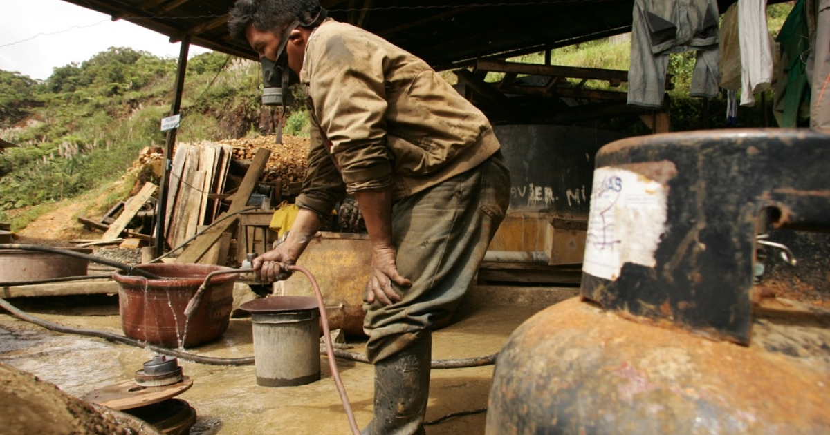 Independent miner Isidro Jayo employs mercury to separate the gold from the gravel at his mine near Nambijain southern Ecaudor, on Feb. 28, 2008.</p>