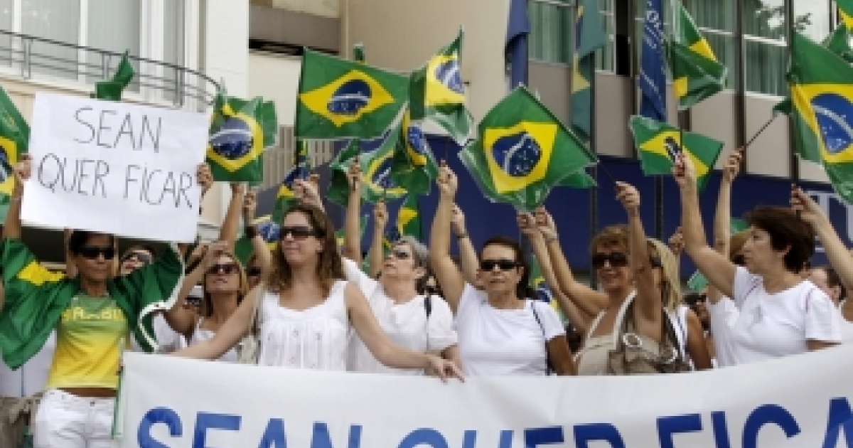 Protesters demonstrate in Rio de Janeiro March 15, 2009 against U.S. citizen David Goldman, who has been fighting for custody of his son Sean since his then-wife took the boy on vacation to her native Brazil. The banner reads: