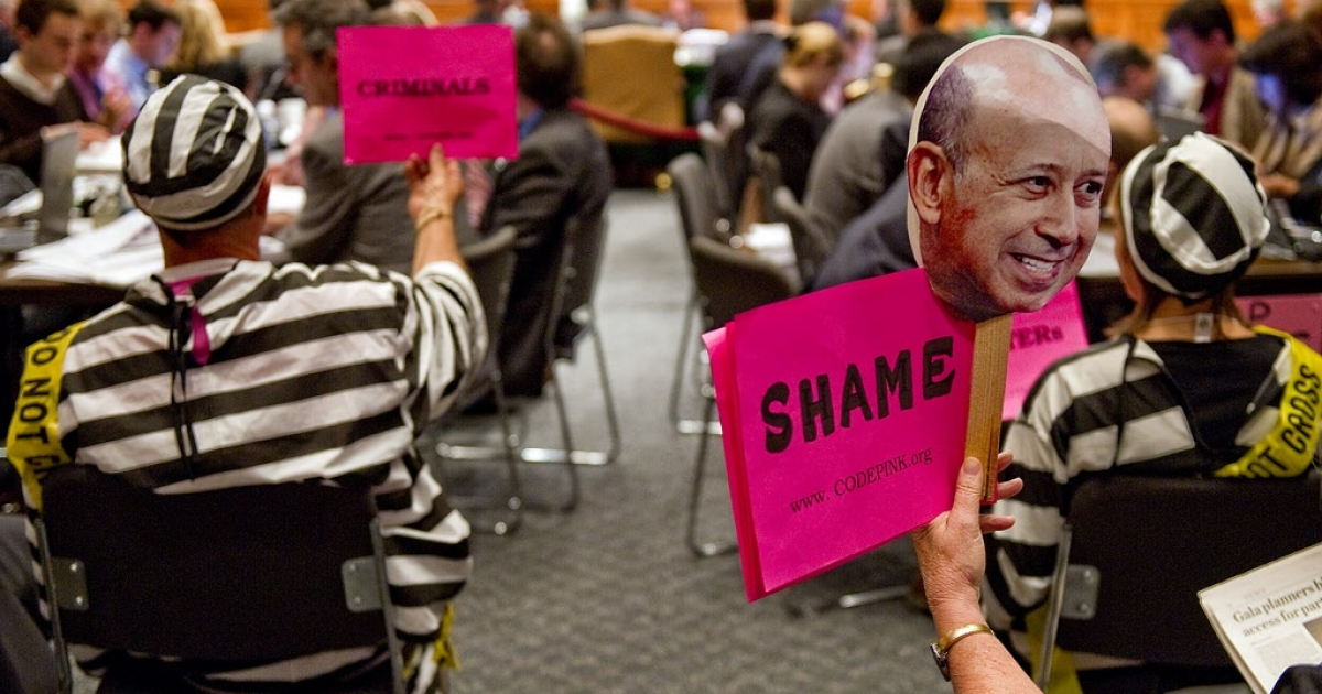 Code Pink demonstrators hold placards during a Senate hearing on April 27, 2010. Goldman Sachs denied reaping vast profits from the collapse of the US housing market as its top executive and a star trader faced hostile questions in Congress over the 2008 financial meltdown.</p>