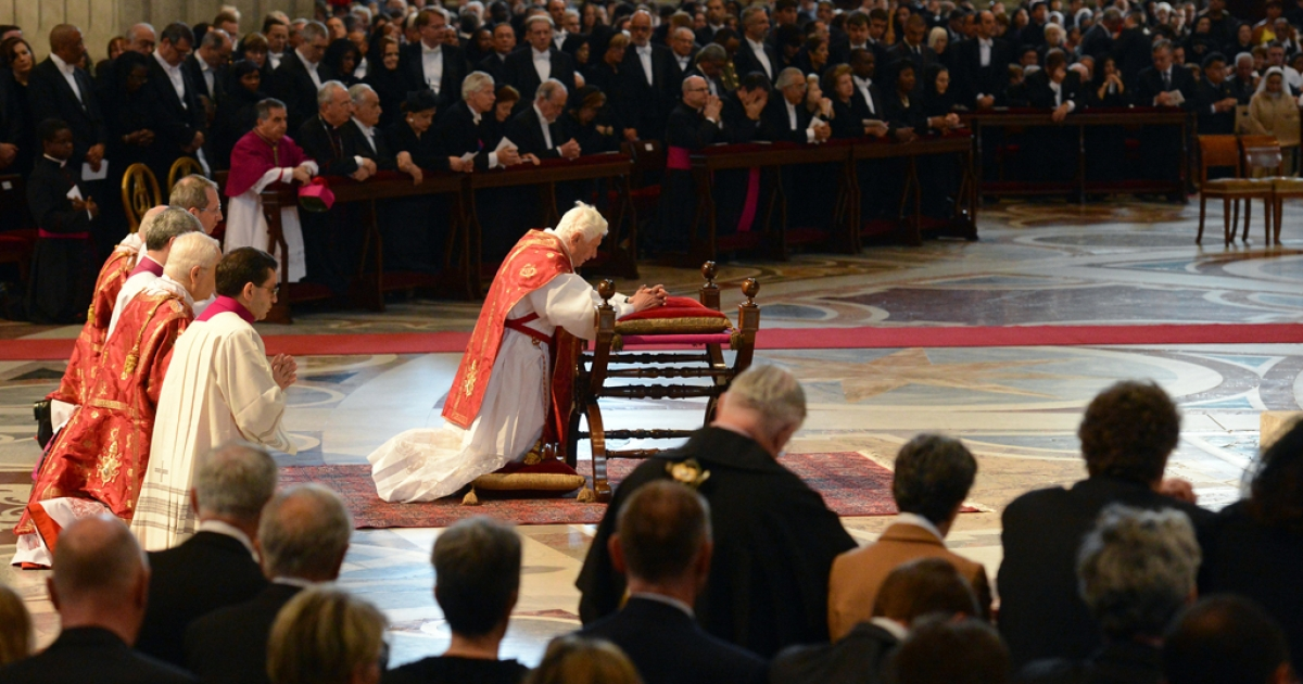 Pope Benedict XVI (C) prays during the Celebration of the Lord's Passion on Good Friday on April 6, 2012 St Peter's basilica at The Vatican. Christians mark the crucifixion of Jesus Christ on Friday in a series of ceremonies culminating on Sunday, when they celebrate Christ's resurrection.</p>