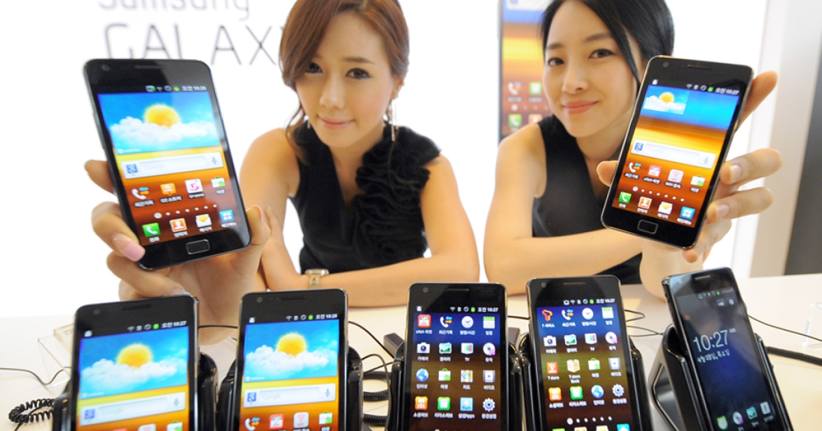 Models pose with Samsung Galaxy S2s during its launch in Seoul, Korea on April 28, 2011. The Galaxy S2 runs on the Android operating system, which just racked up its 10 billionth app download for Google.</p>