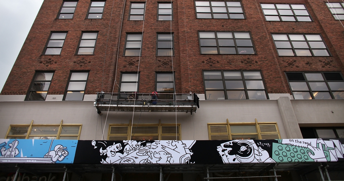 "A vinyl mural attached to the scaffolding wrapping around Google's New York headquarters in Chelsea along Eighth Avenue is seen on April 10. The cartoons on the 450-by- 4-foot mural were drawn by Mark Miller and Dave Franzese of the Brooklyn design studio Dark Igloo. Jack Kerouac, who wrote ""On the Road"" at the Hotel Chelsea is included in the mural as is Major Thomas Clark, who named the neighborhood in the 1700s. The scaffolding and mural will be up through the end of May.</p>"