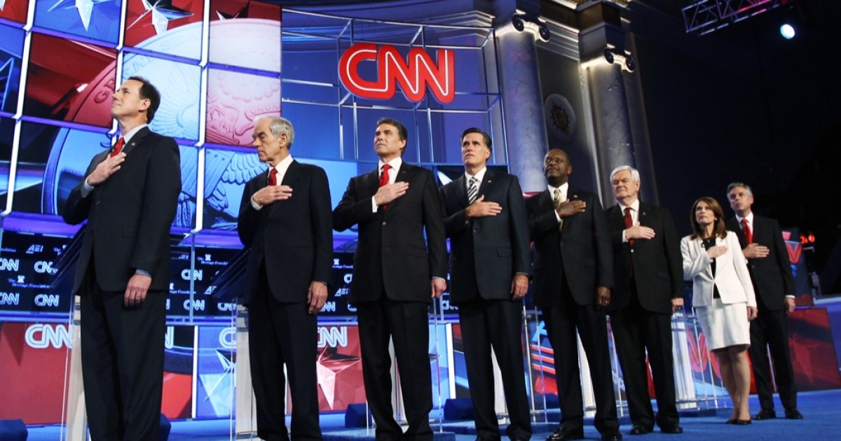 Republican presidential candidates (L-R) Rick Santorum, Rep. Ron Paul (R-TX), Texas Gov. Rick Perry, Mitt Romney, Herman Cain, Newt Gingrich, Rep. Michele Bachmann (R-MN), and Jon Huntsman are introduced prior to a debate at Constitution Hall November 22, 2011 in Washington, DC.</p>