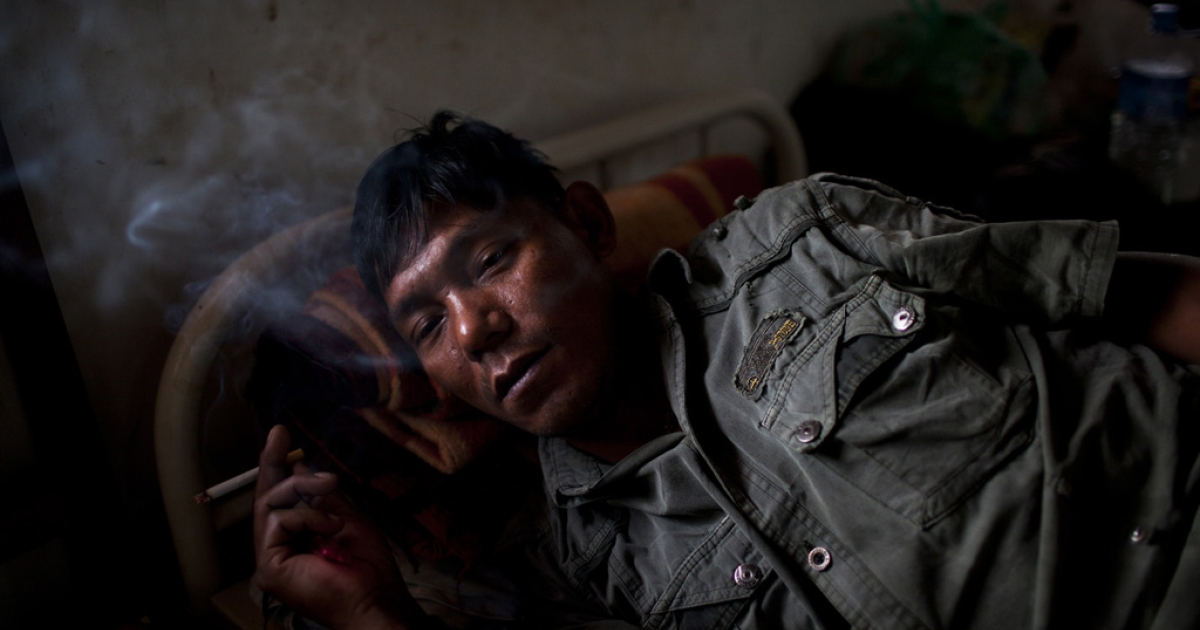 An injured Kachin Independence Army soldier recovers at Laiza Military Hospital, near Laiza, Myanmar, March 30, 2012.</p>