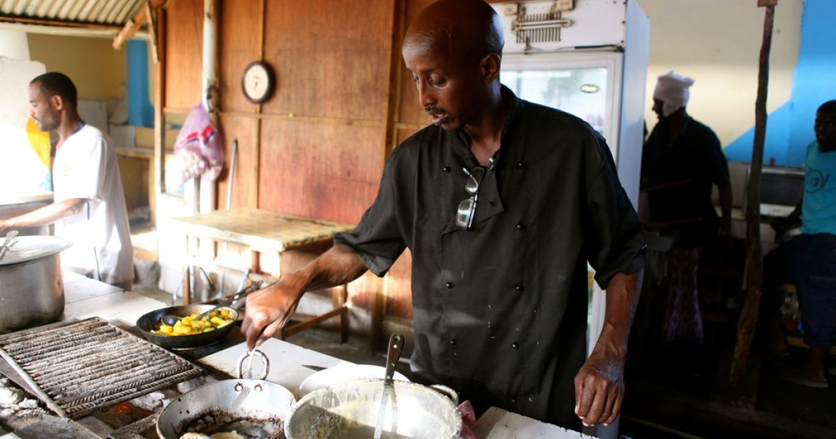 British-trained Somali chef Ahmed Jama prepares food in the open kitchen at his Village Restaurant in Mogadishu.</p>