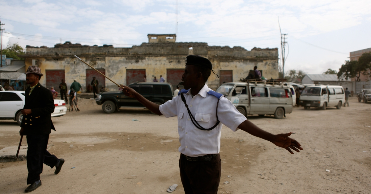 In a sign that a kind of normality is returning to Mogadishu, a traffic policeman directs vehicles at the city's main 'K4' roundabout.</p>