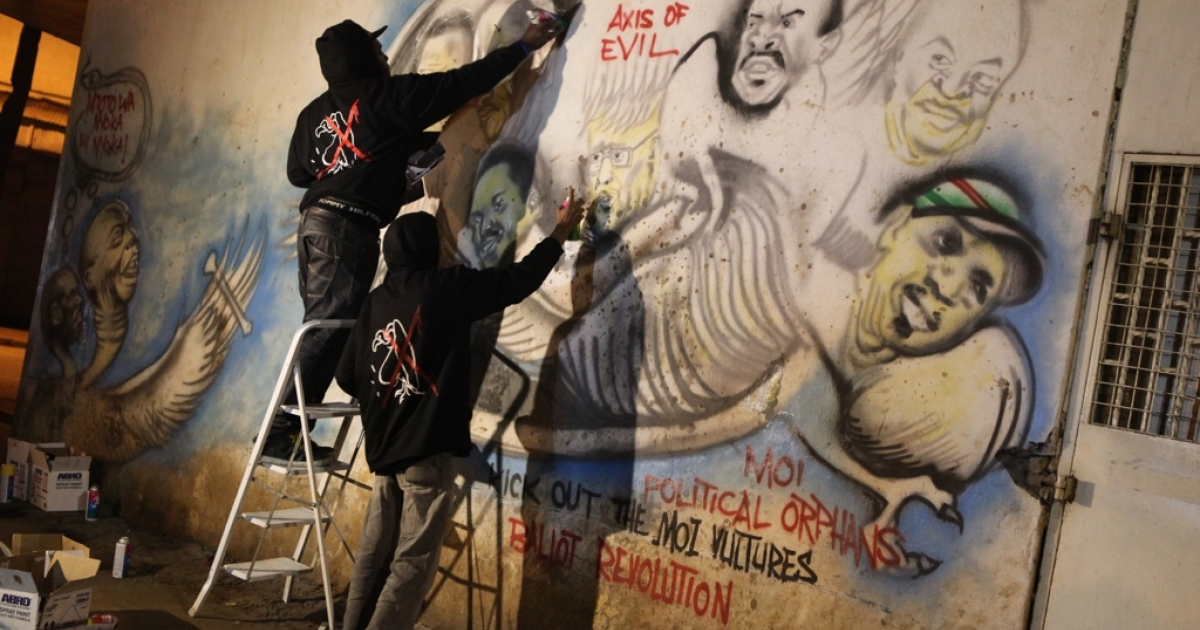 Nairobi graffiti artists paint a political protest against corrupt politicians.</p>