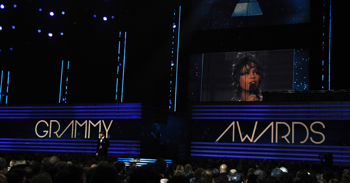 Guests pay respect to the late singer Whitney Houston at the Staples Center during the 54th Grammy Awards in Los Angeles, California, February 12, 2012.</p>