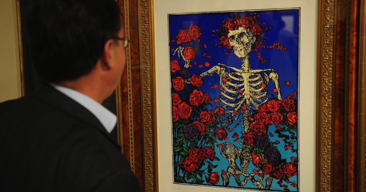 A man looks at a piece of artwork titled