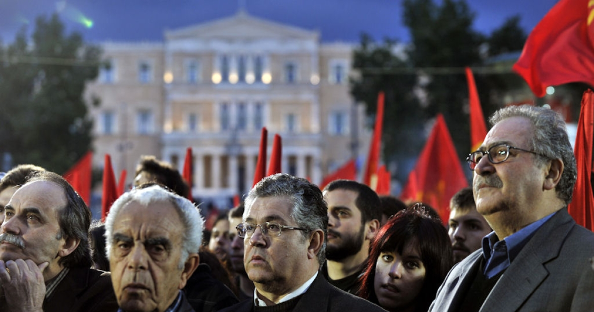 Pro-Communist Party Greeks participate in a protest rally against austerity measures at central Athens square on April 18, 2011.</p>