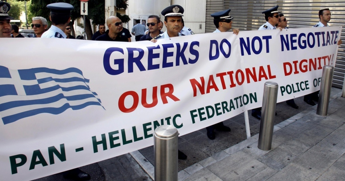 Greek policemen and firemen protest outside the German embassy in central Athens, on September 22, 2011.</p>