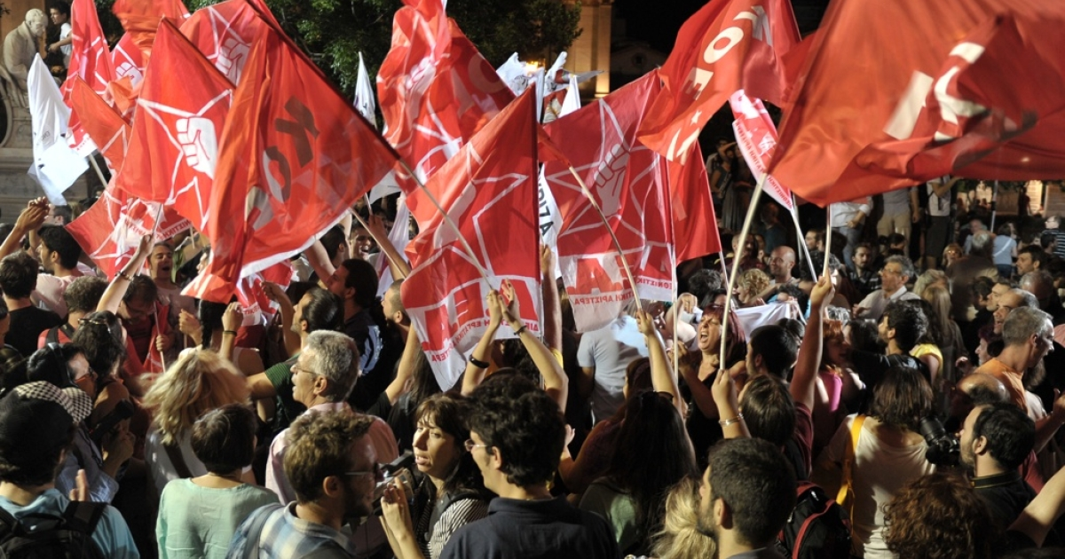 Radical left Syriza party supporters listen to their leader making a speech on June 17, 2012, outside the University of Athens.</p>