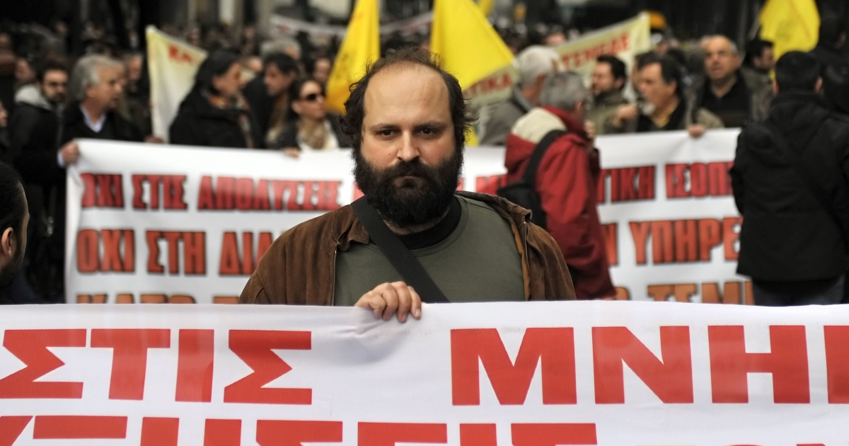 Greek state-employed mechanics protest in Athens against salary cuts and lay-offs on February 3, 2012.</p>