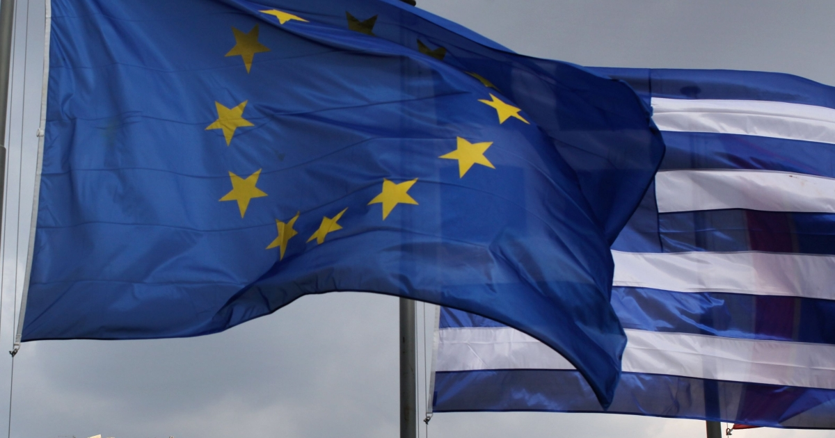 The EU and Greek flags fly in front of the Parthenon in Athens, Greece on February 17, 2012.</p>