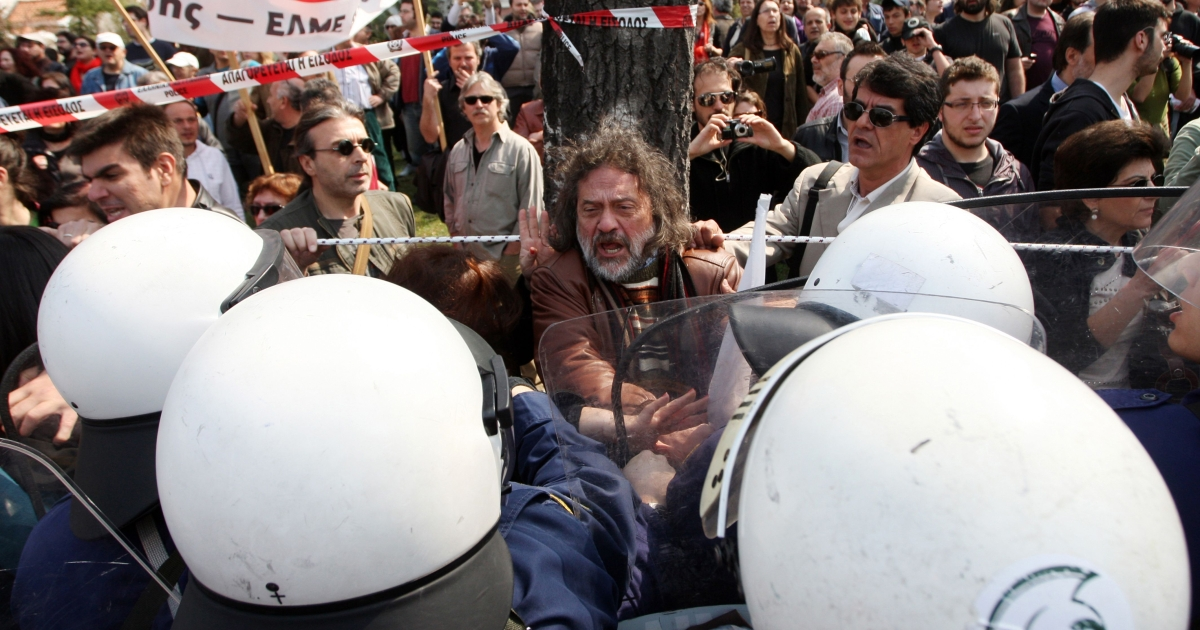 Demonstrators scuffle with riot police in Athens during Greece's Independence Day celebrations on March 25.</p>