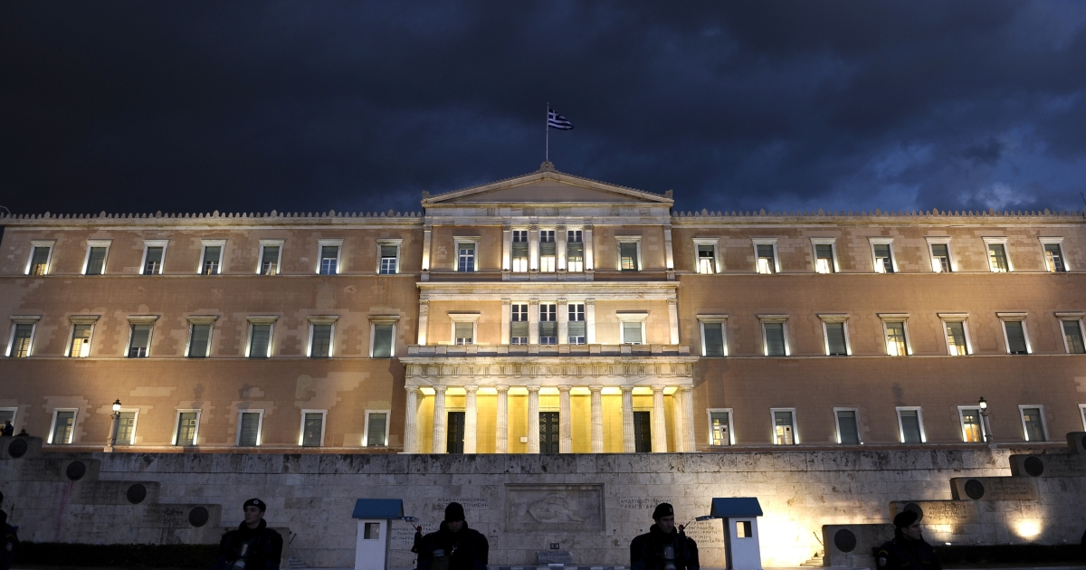 Police guard the Greek parliament in Athens on Feb. 29, 2012.</p>