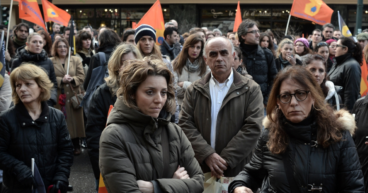 Striking Hellenic Postbank employees gather outside the offices of the Hellenic Financial Stability Fund in Athens, Greece, on Jan. 16, 2013, protesting against the bank's plans to split and privatize. The situation with Postbank shows the challenges facing Athens as it attempts to restructure its banks and restore fiscal solvency.</p>