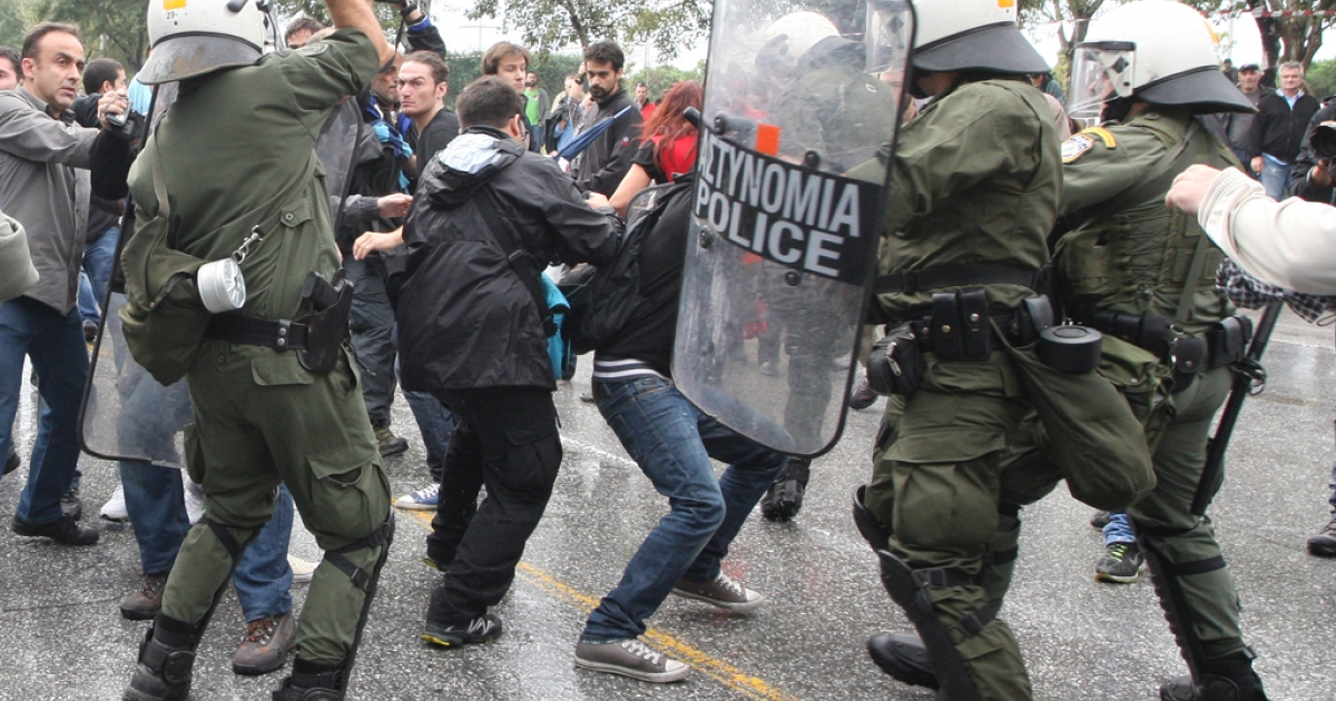 Demonstrators clash with riot police on October 28, 2012 during a protest against austerity measures in the northern Greek city Thessaloniki during the annual celebrations of the National No Day, commemorating Greece's refusal to surrender to Italian dictator Benito Mussolini's invading troops in 1940.</p>