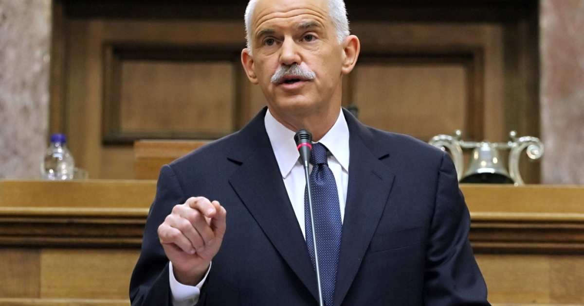 Greek Prime Minister George Papandreou gestures during his speech to the Panhellenic Socialist Movement (PASOK) parliamentary group at the Greek parliament in Athens on October 31, 2011. Papandreou called for a confidence vote and a referendum to approve last week's EU summit deal.</p>