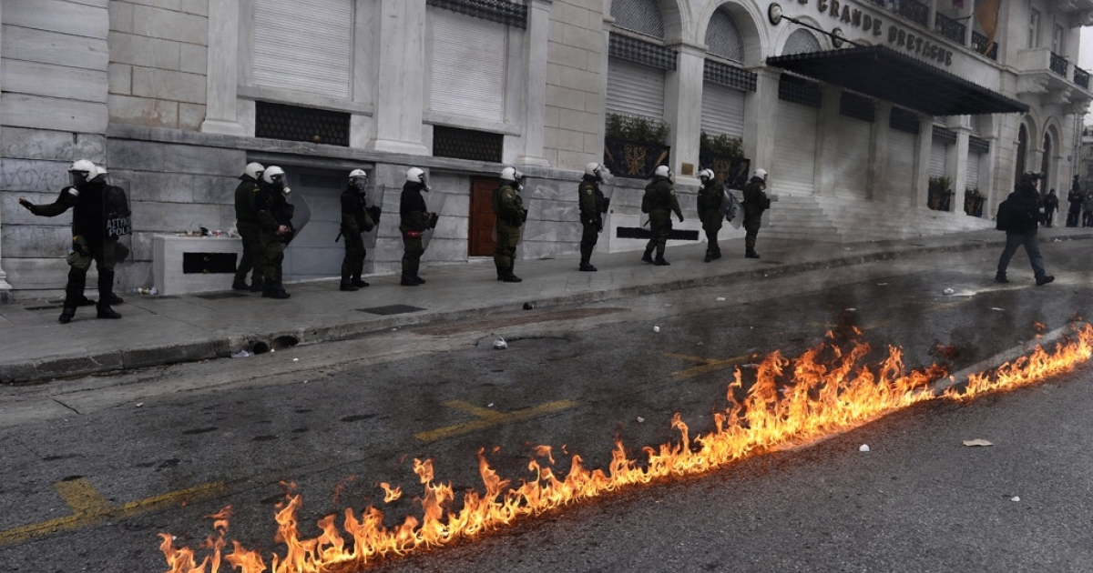 Riot police clash with protesters during a 48-hour general strike in Athens on February 10, 2012. Greek protesters threw stones and firebombs at riot police who responded with tear gas in Athens on February 10 as clashes erupted on the sidelines of a protest against new austerity cuts.</p>
