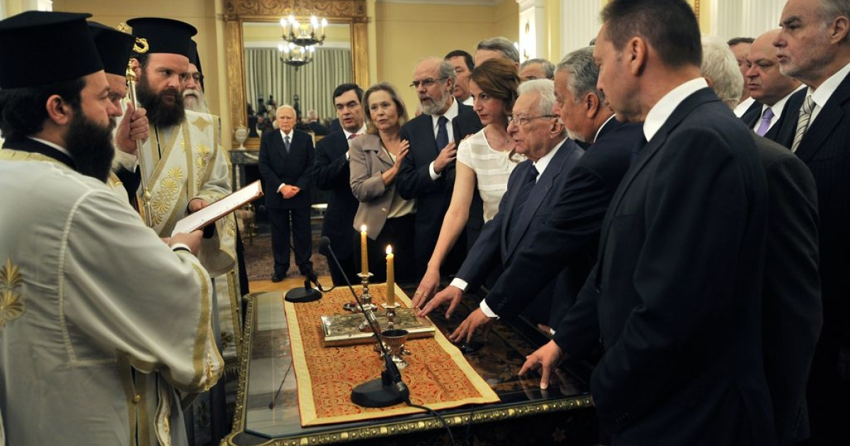 Greece's newly appointed caretaker cabinet is sworn in during a ceremony with church leaders at the presidential palace in Athens, May 17, 2012.</p>