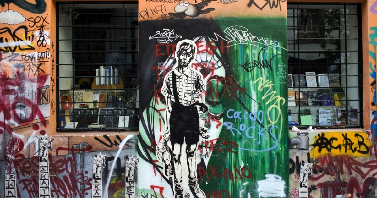 Anti-austerity graffiti is displayed on a building in Athens, Greece, on Dec. 6, 2011.</p>
