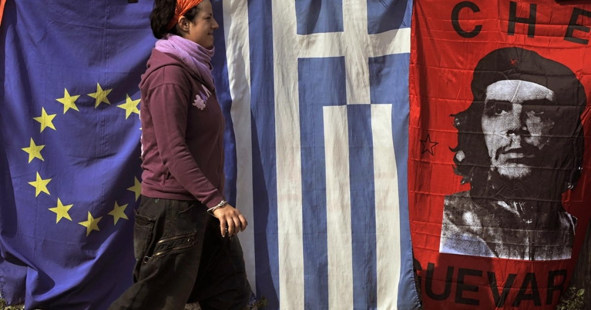 Should democracy prevail in the birthplace of democracy? A woman walks by flags of the European Union, Greece and Che Guevara in central Athens on November 2, 2011. European leaders summoned the Greek prime minister to the French riviera on Wednesday to restore calm on the eve of a G20 summit.</p>