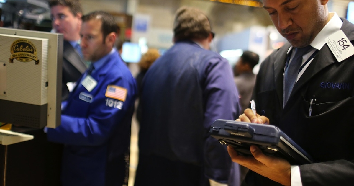 NEW YORK, NY: Traders work on the floor of the New York Stock Exchange on June 18, 2012 in New York City. After early gains in world markets due to the Greek voters rejecting the leftist anti austerity party, the Dow Jones industrial average fell 52 points, or 0.4%. in morning trading.</p>