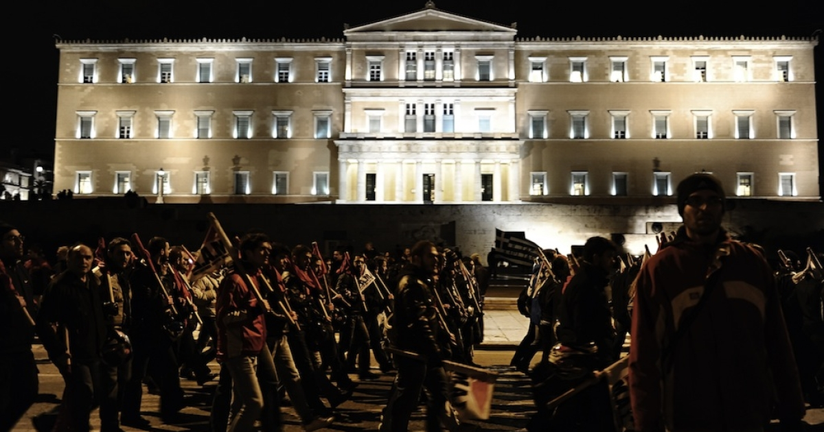 Protesters march in front of the parliament during a demonstration in Athens on February 9, 2012. Greece's main unions today called a 48-hour strike, the second this week, over new austerity cuts agreed by the country's coalition government in return for bailout loans. AFP PHOTO/ ARIS MESSINIS (Photo credit should read ARIS MESSINIS/AFP/Getty Images)</p>