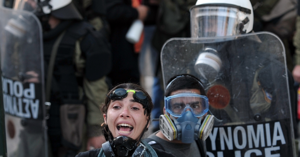 A demonstrator shouts in Athens on October 20, 2011. After repeated clashes with police, Greeks have become skilled at choosing the right protective gear. Maalox is a must.</p>