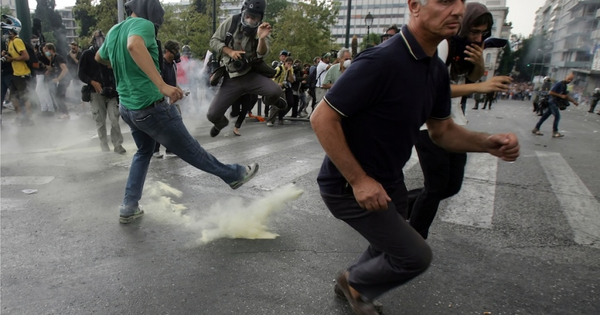 In another sign of major discord in the EU, demonstrators in Greece clashed with riot police during a protest against a visit by Germany's Chancellor Angela Merkel in Athens, October 9, 2012. The EU was awarded the Nobel Peace Prize this morning, but some don't see why.</p>