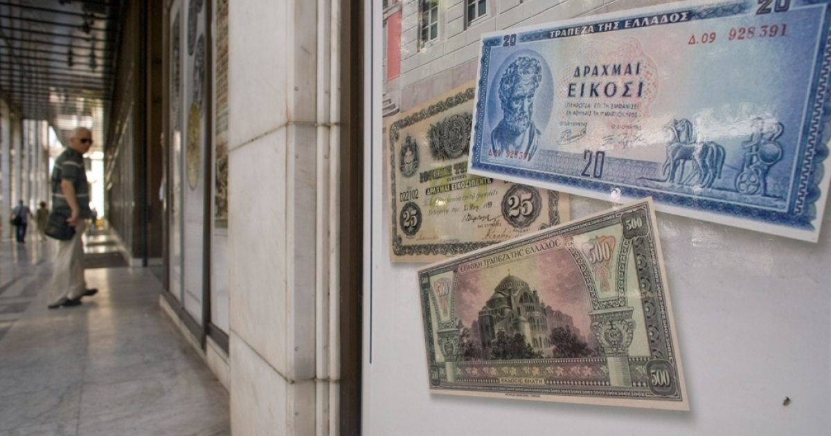 Replica drachma notes on display outside a bank on June 14, 2012 in Athens, Greece.</p>