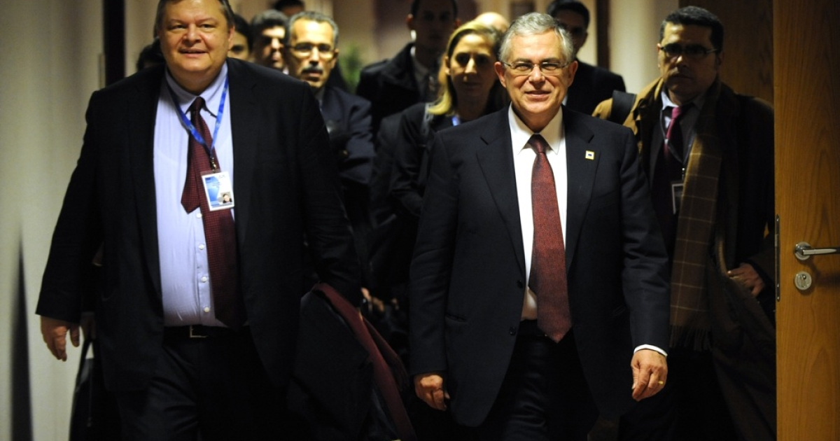 Greek finance minister Evangelos Venizelos (L) and Greek Prime Minister Lucas Papademos arrive for a joint press conference following a European Union summit at the EU headquarters on January 30, 2012 in Brussels.</p>