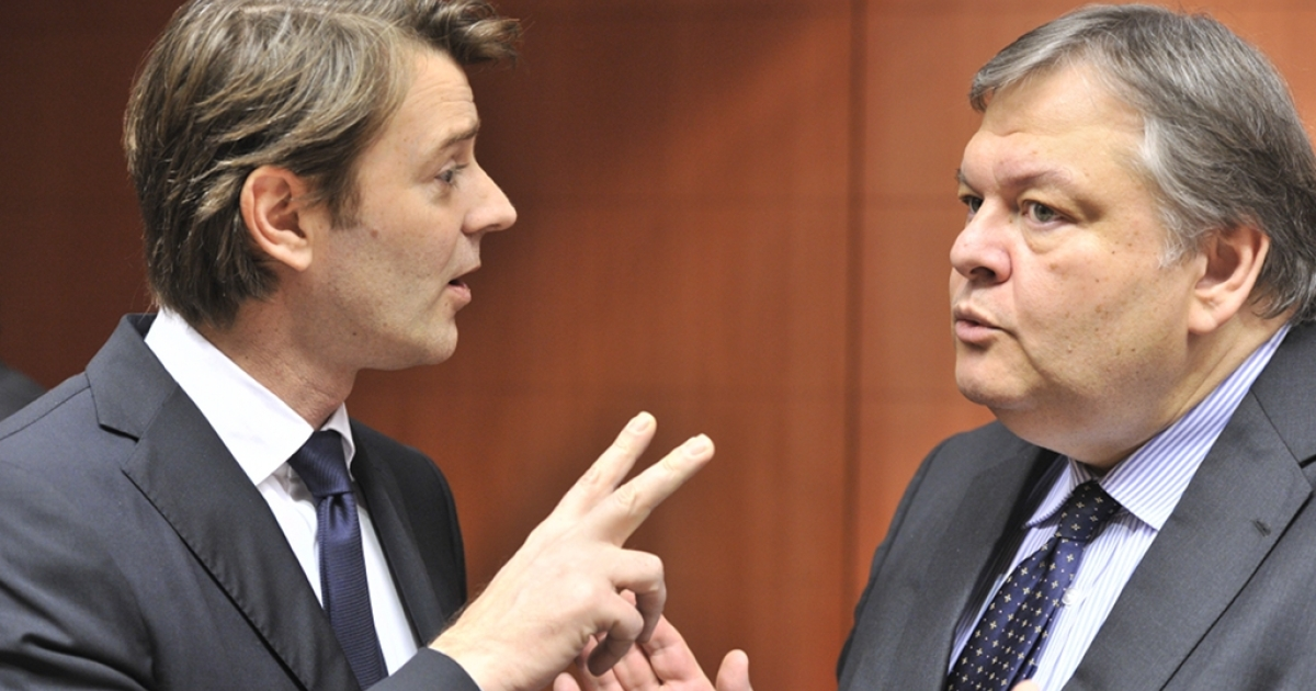 French Finance minister Francois Baroin (L) speaks with Greek Finance Minister Evangélos Vénizélos on January 23, 2012 before the euro zone finance ministers' meeting at EU headquarters in Brussels</p>