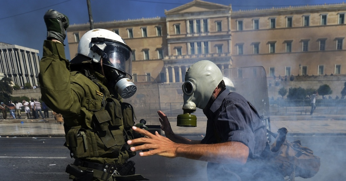 Demonstrators clash with riot police in Athens on September 26, 2012.</p>
