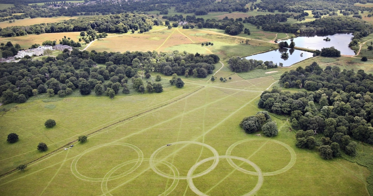 An aerial view of Olympic Rings cut into the grass of Richmond Park, London, England.</p>