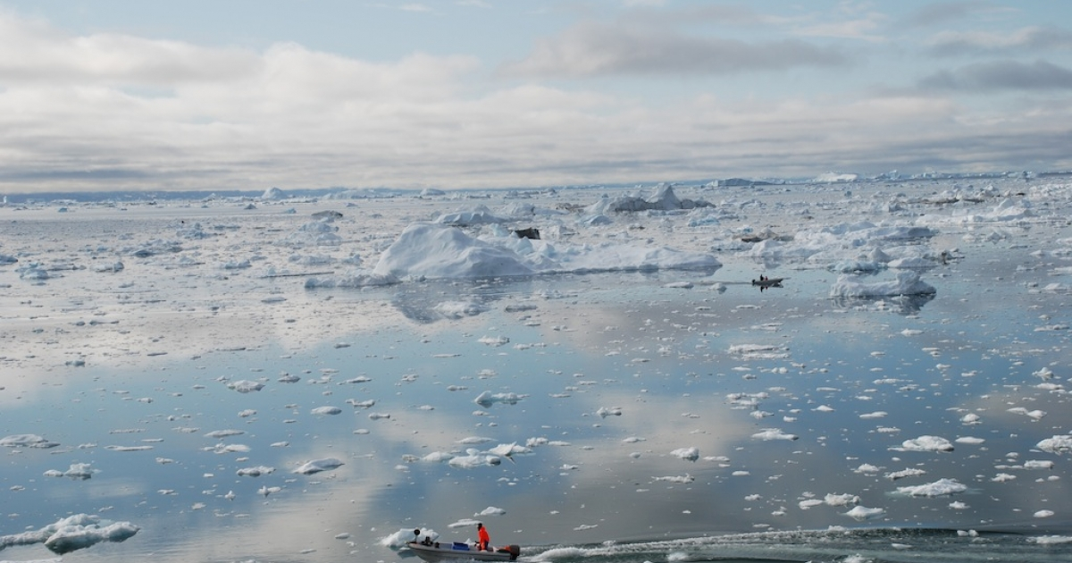 A fisherman sails on the Ice Fjord of Ilulissat, Greenland on July 3, 2009. The Ilulissat glacier lost 94 square kilometres (60 square miles) of surface area from 2001 to 2005 due to global warming, according to a US study published last year.</p>