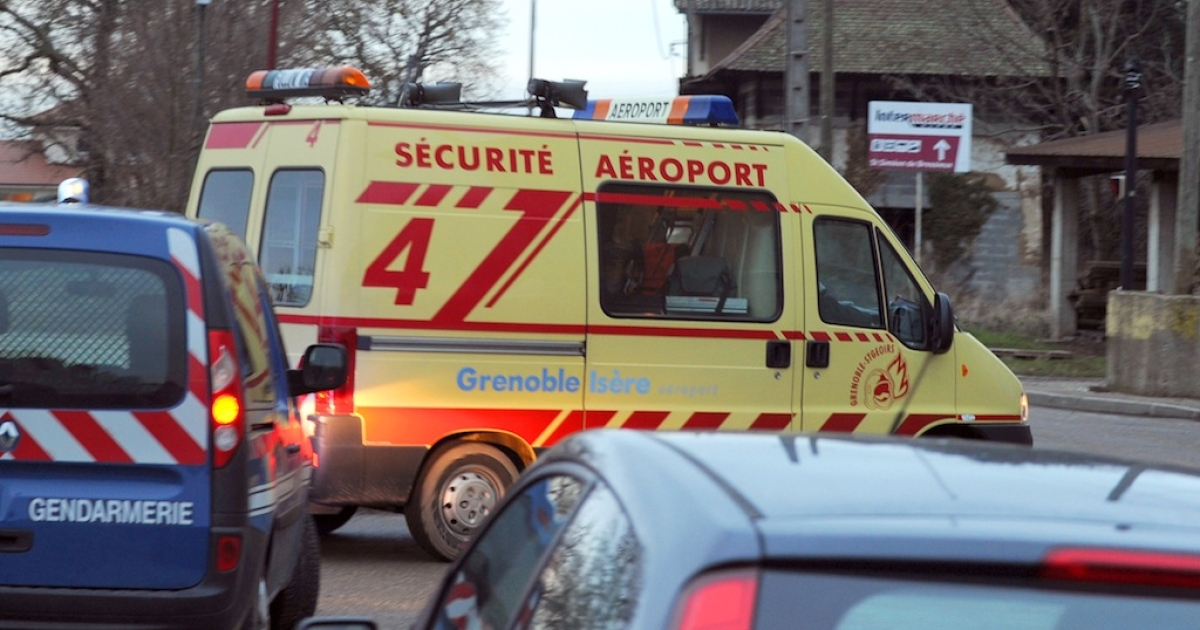 An airport security van leaves the site of a small plane crash in Saint-Geoirs, on January 5, 2013. Five people died when their private plane crashed a few moments after taking off from the Grenoble airport in southeastern France, local police said.</p>