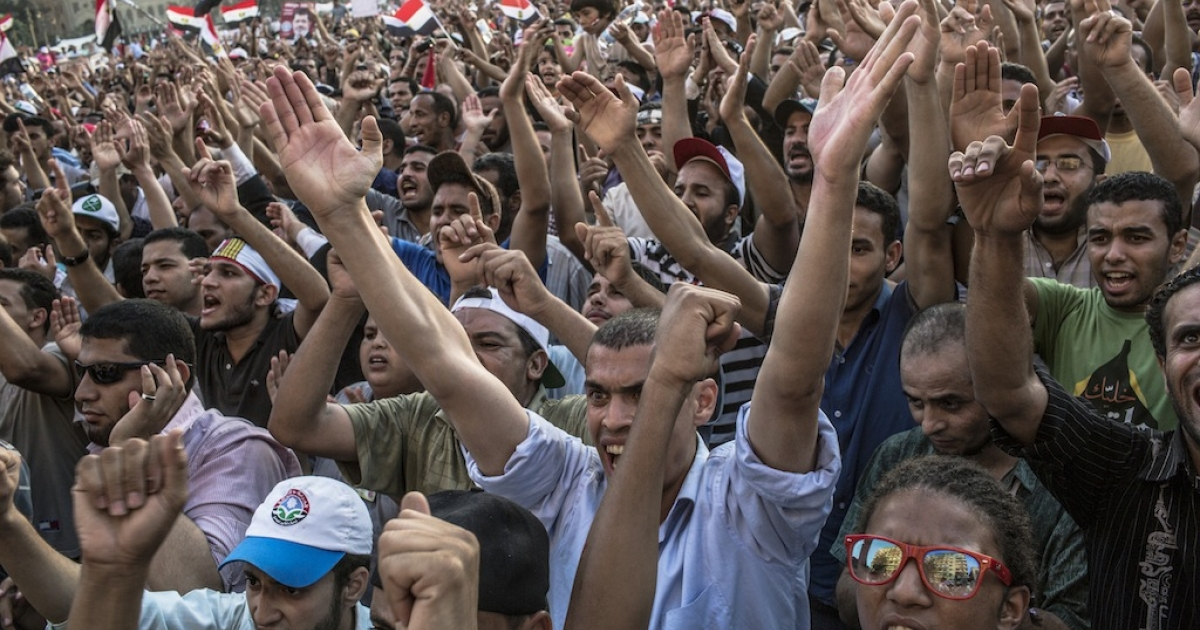 Protesters chant against Egypt's military rulers in Tahrir Square on June 21, 2012 in Cairo. Many young people feel the Muslim Brotherhood is complicit in the military's increased power.</p>