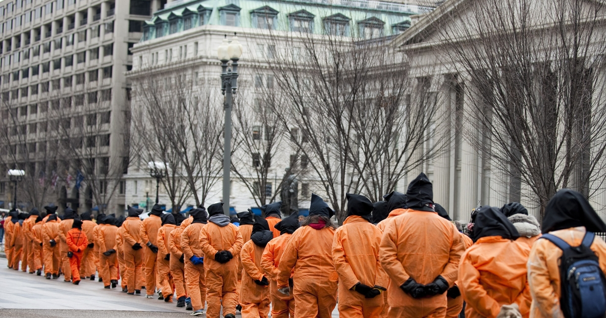 Demonstrators with Witness Against Torture march to the Department of Justice in Washington, DC, Jan. 11, 2011, during a day of action and protest calling for the closure of Guantanamo Bay detention camp.</p>