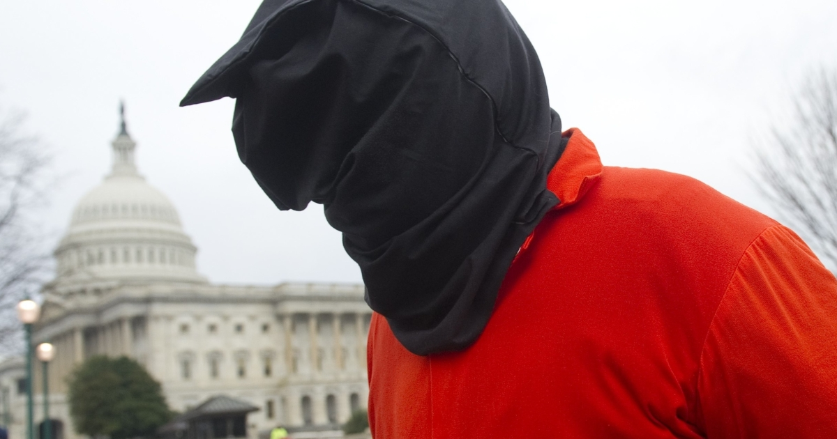 A protester dressed like a Guantanamo prisoner demonstrates against holding detainees at the US military prison in Guantanamo Bay during in front of the US Capitol in Washington, DC, on Jan. 11 — the 10th anniversary of the arrival of the first group of detainees to be held at the prison.</p>