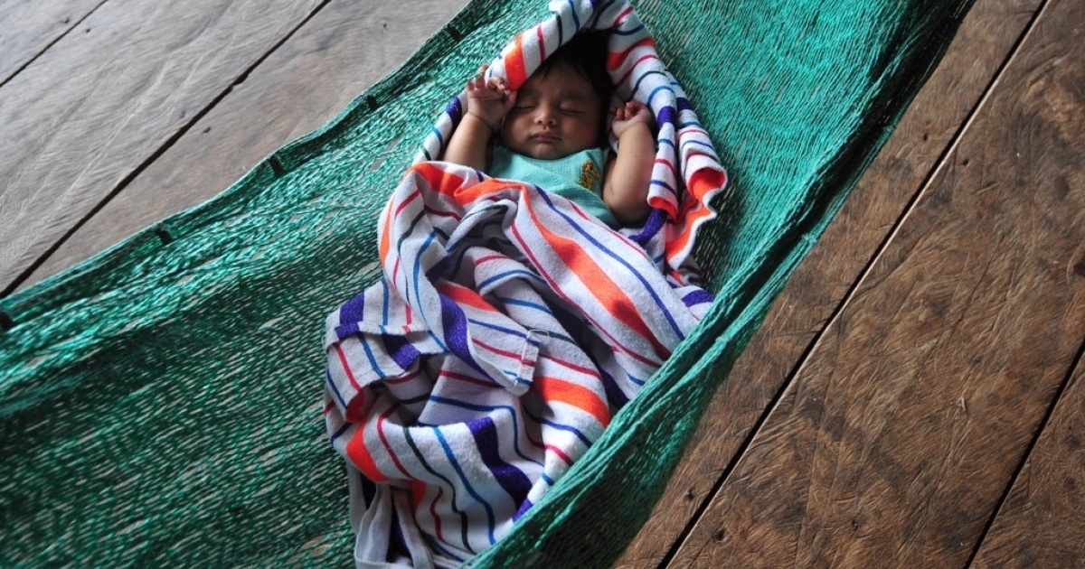 A baby sleeps in a hammock in Rio Dulce, about 110 miles northeast of Guatemala City. Guatemala is one of the countries that are part of U.S. President Barack Obama's Global Health Initiative.</p>