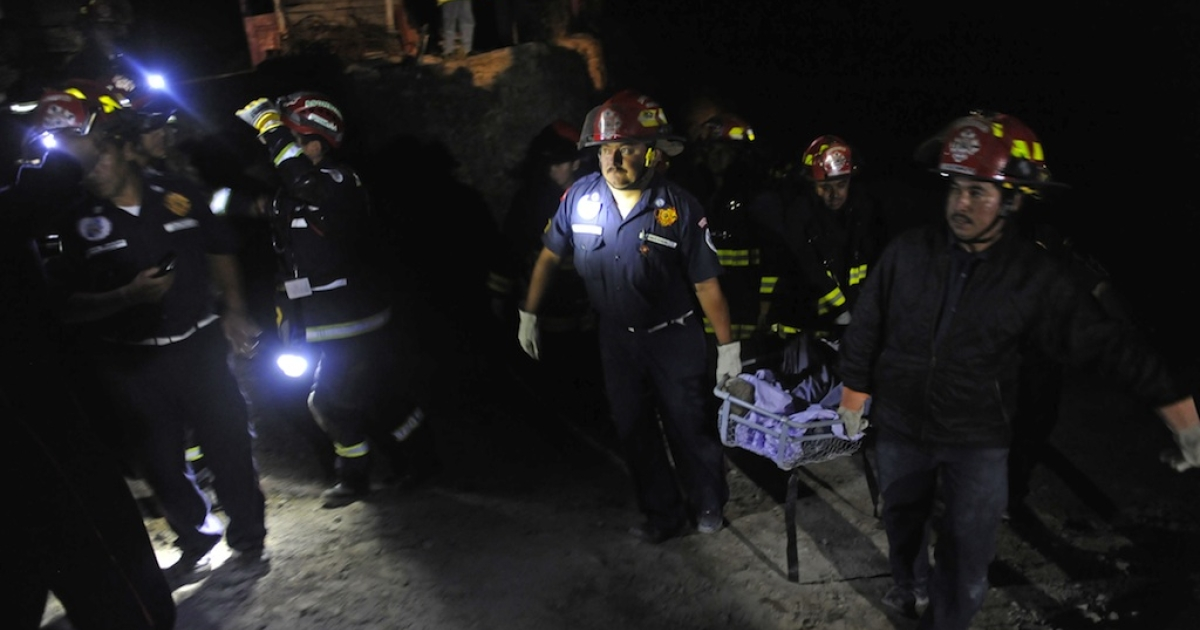 Firefighters carry the body of one of four people killed in San Marcos, in northwestern Guatemala, after a 7.4-magnitude earthquake struck off the Pacific coast of the Central American country on Wednesday.</p>