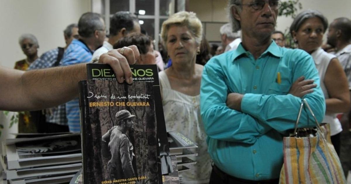 People wait in line in Havana, Cuba, to receive a copy of the new
