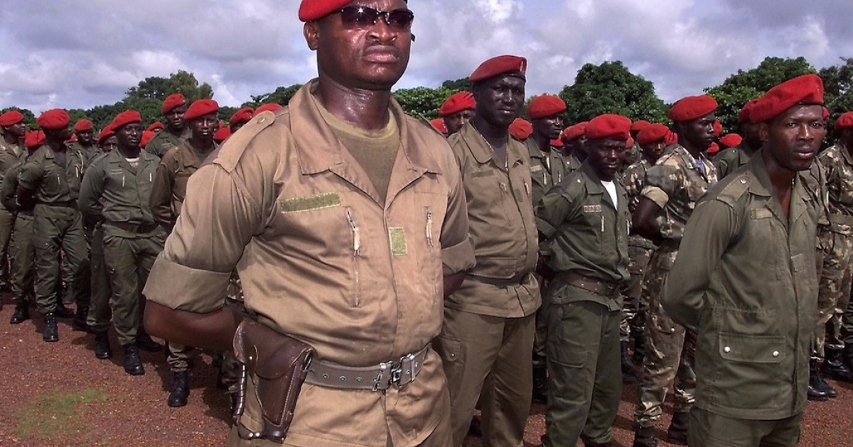 Soldiers of Guinea-Bissau at a military camp on July 22, 2003. On September 14, 2003, the Guinea-Bissau military staged an apparently bloodless coup, overthrowing President Kumba Yala.</p>