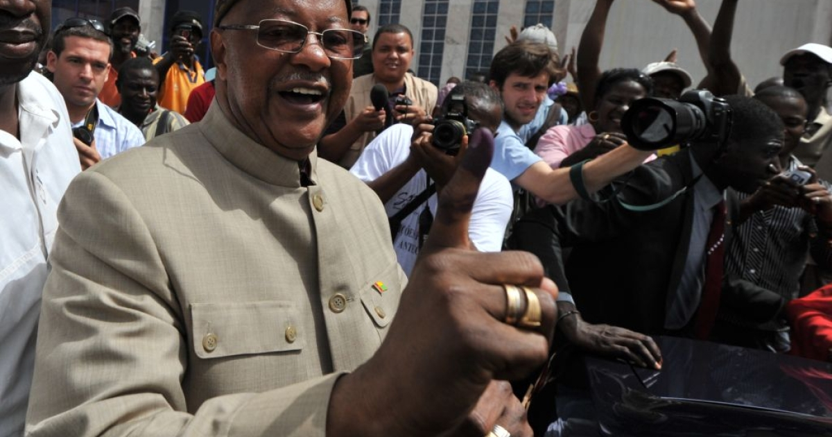 Guinea-Bissau presidential candidate and Prime Minister Carlos Gomes Junior shows an inked finger after casting his vote in the first round of presidential elections on Mar. 18.  He is now missing after his home was attacked during an attempted coup.</p>