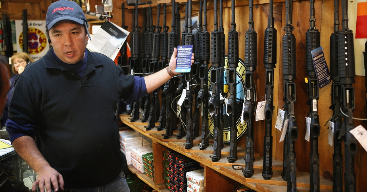 Guns fly off the shelf Dec. 17, 2012 in Tinley Park, IL.</p>