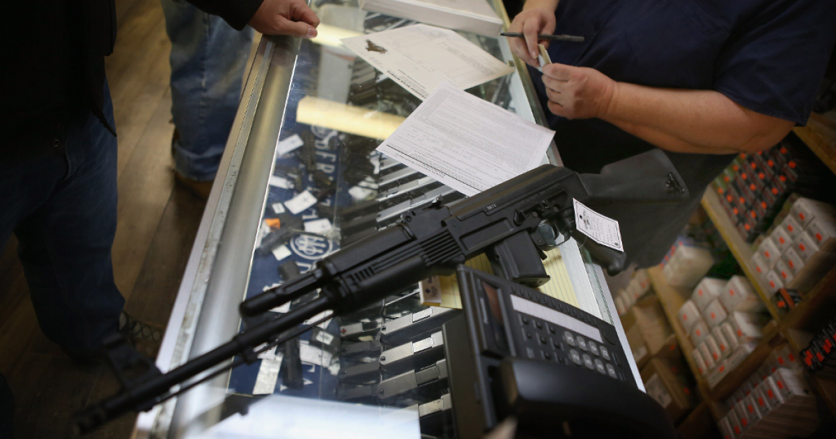 An assault rifle is purchased on Dec. 17, 2012 in Tinsley Park, IL.</p>