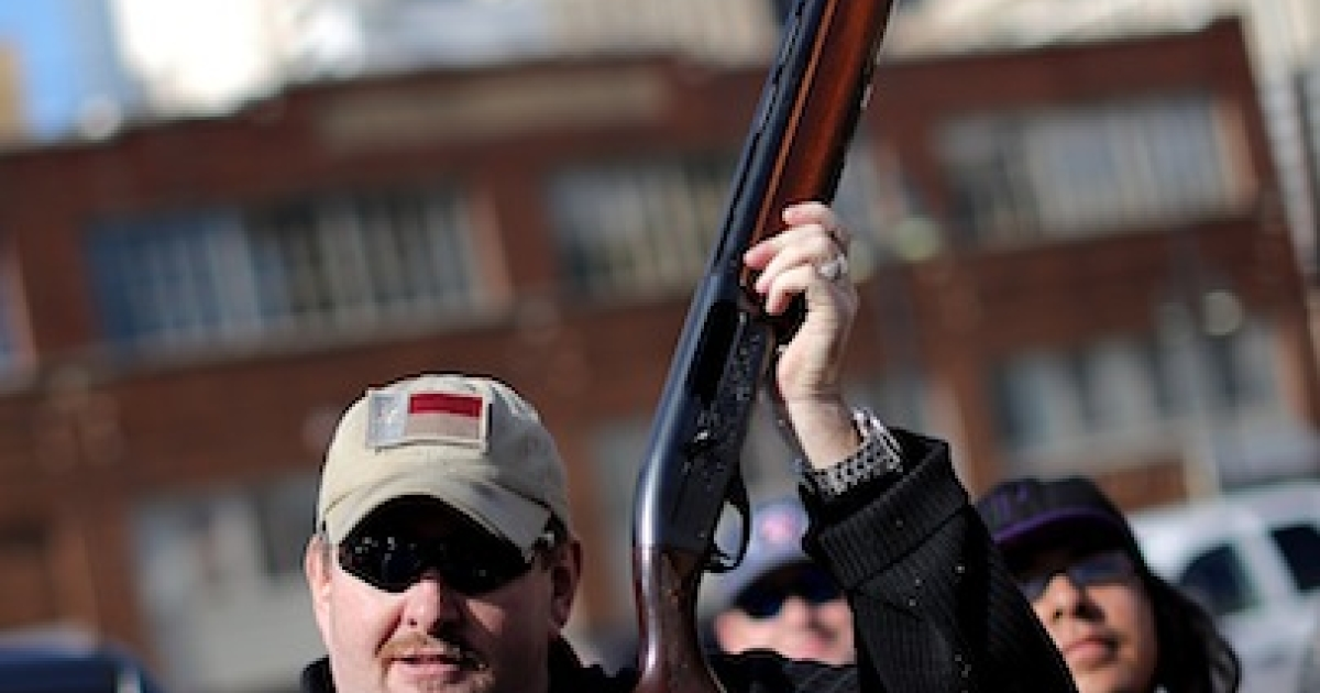 DALLAS, TX - JANUARY 19: Second Amendment supporter and gun enthusiast Derek Ringley displays an unloaded shotgun that was being sold in an impromptu auction across the street from a gun buy back program at the First Presbyterian Church of Dallas on January 19, 2013 in Dallas, Texas. President Barack Obama recently unveiled a package of gun control proposals that include universal background checks and bans on assault weapons and high-capacity magazines.</p>